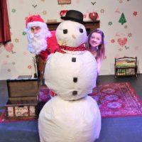 Santa In Love Santa and fairy behind snowman